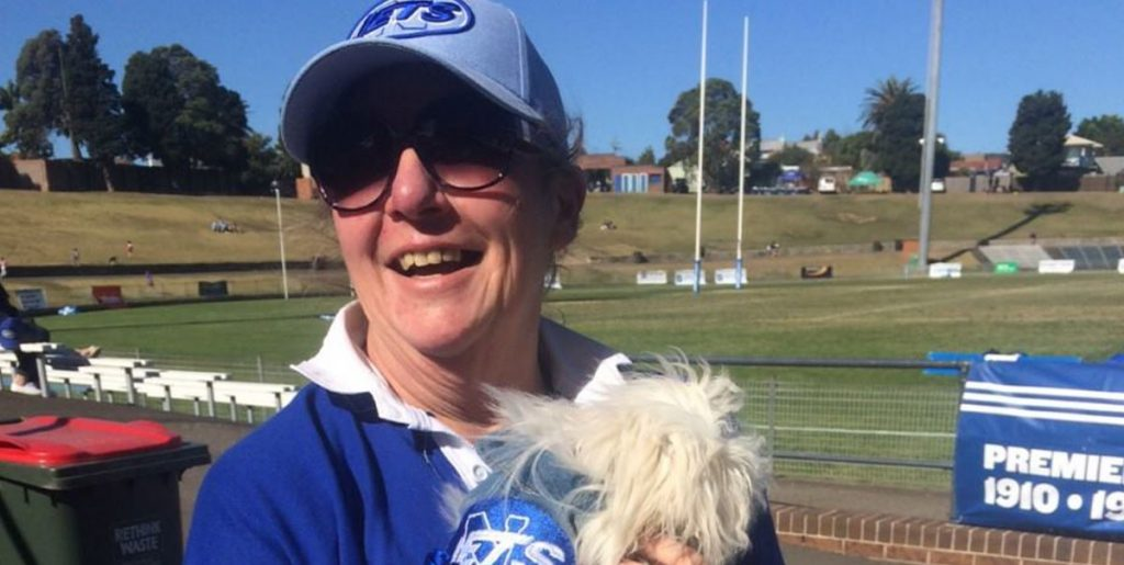 Jets member Kim Fuller with her dog. Takisha (Supplied).