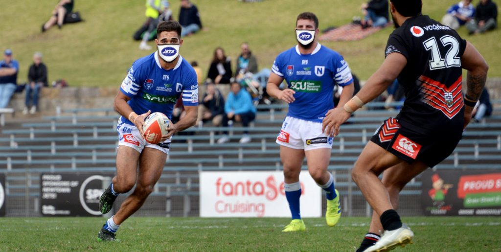 Take on the line in a Newtown Jets face mask. Photo: Mike Magee