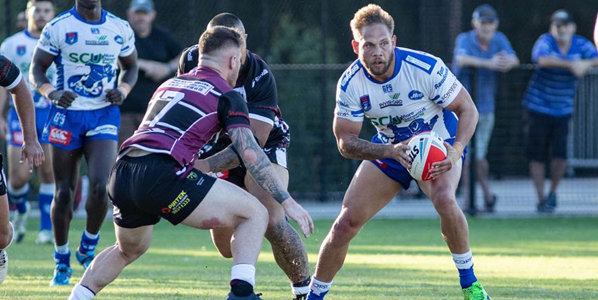 Above: Newtown Jets five-eighth Lachlan Peachey (in possession) schemes to prise open the Blacktown Workers defence last Saturday. Photo: Mario Facchini, mafphotography