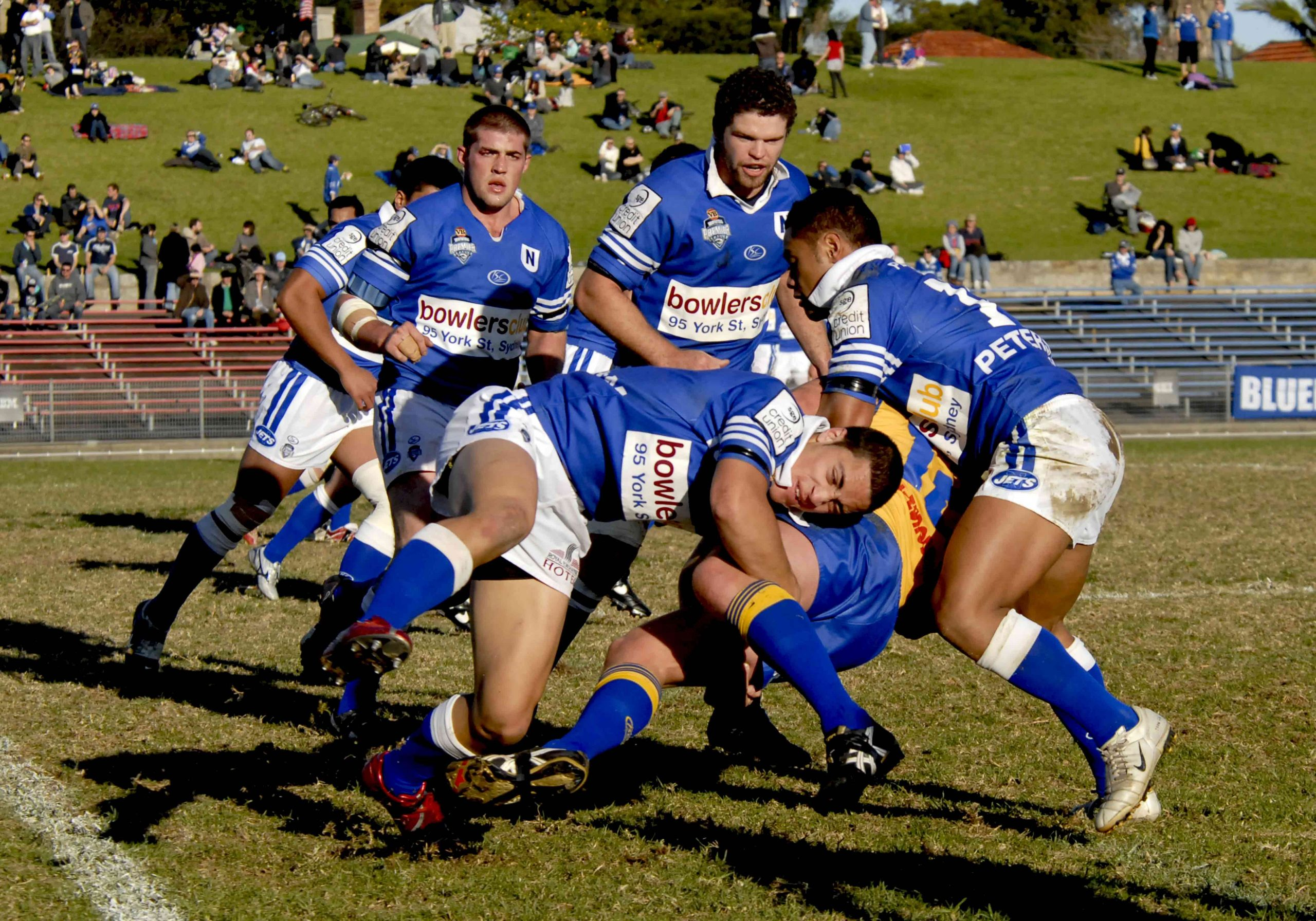 In front, left to right, Newtown Jets players Troy Savage and Hermani Moala wrap up a Parramatta player in this match at Henson Park on the 23rd June 2007.  Dale Newton (left) and Adam Schubert are the Newtown Jets players in the rear.     Photo: Gary Sutherland Photography.