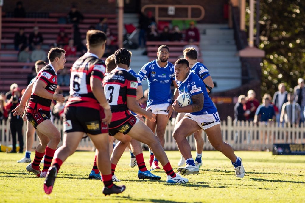 Big front-rower and Australian Schoolboy representative Franklin Pele might still be eligible for the Cronulla Sharks Jersey Flegg team, but he made a strong impression in his senior rugby league debut with the Newtown Jets at North Sydney Oval on Sunday. He is pictured here charging into the thick of the North Sydney Bears defence. Photo: Mario Facchini, mafphotography