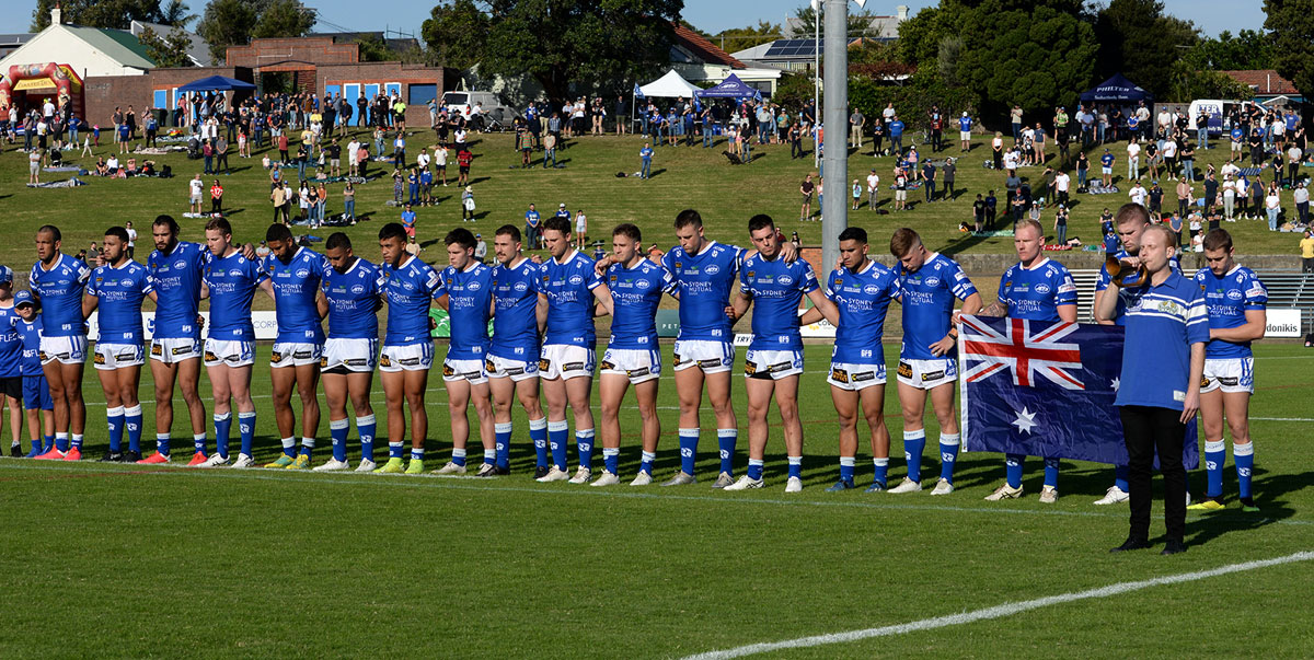 The Newtown Jets team members stand to attention in the pre-Anzac Day ceremony conducted at Henson Park on Saturday, 24th April.     Photo: Michael Magee Photography.