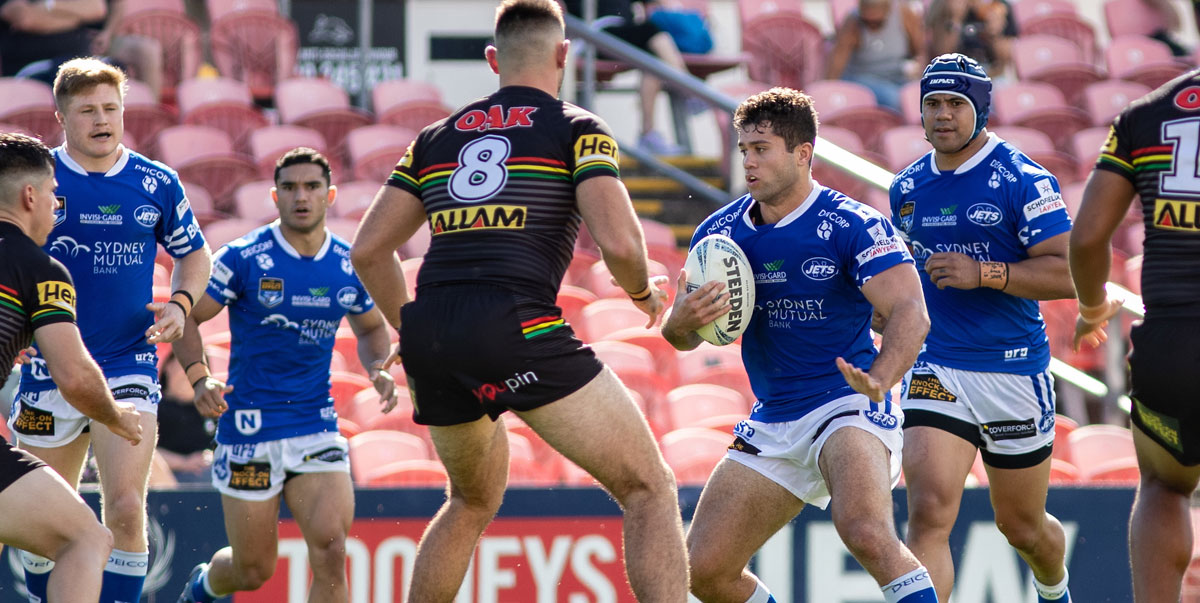 Newtown Jets lock Tyler Slade (in possession) confronts a solid line of Penrith Panthers defenders at BlueBet stadium on Saturday.  The other Newtown players are (from the left): Zac Woolford, Tyla Tamou and Honeti Tuha.     Photo: Mario Facchini, mafphotography