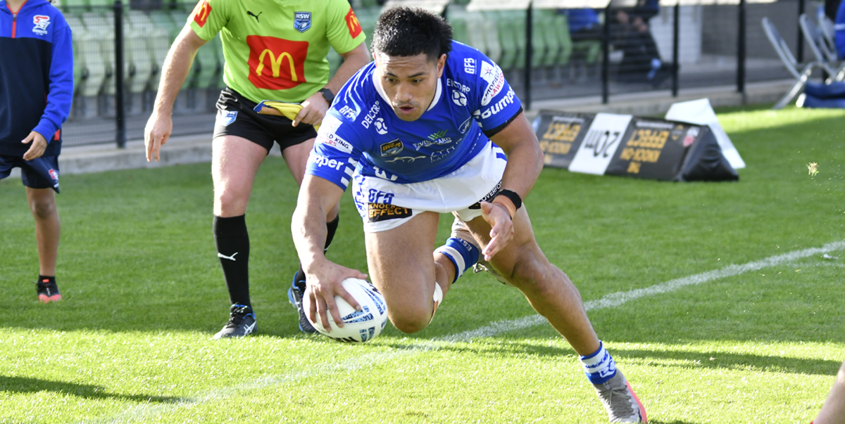 Newtown Jets winger Edward Aiono dives in to score against the Newcastle Knights at the Maitland Sports Ground on Saturday afternoon.  Photo: Amanda Hafey.