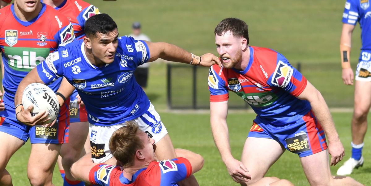 Newtown Jets centre Tyla Tamou (in possession) was injured in last Saturday's match against the Newcastle Knights.     Photo: Amanda Hafey.