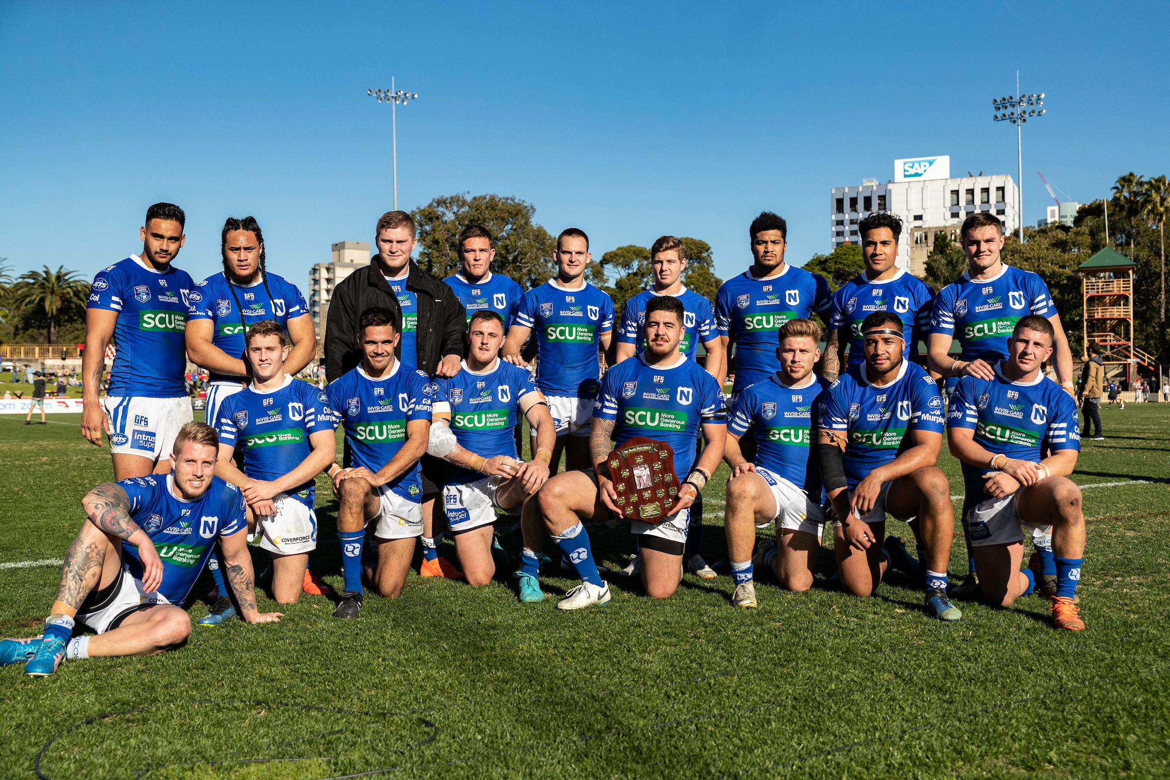 July 14, 2018 - North Sydney, New South Wales, Australia - Newtown Jets players with the Frank Hyde Shield during the NSWRL Intrust Super Premiership Round Eighteen match between the North Sydney Bears and the Newtown Jets at North Sydney Oval in North Sydney, New South Wales. (Mario Facchini/mafphotography)