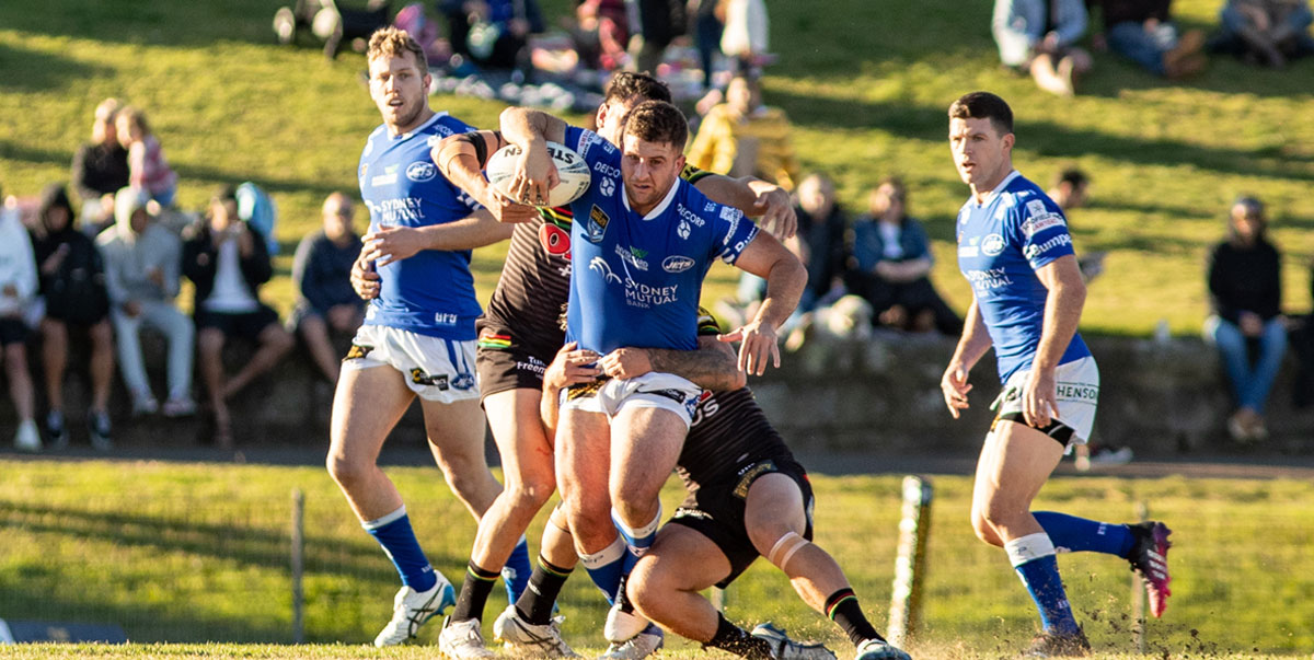 Photo caption: Henson Park crowd favourite Billy Magoulias has his arm free and ready to get a trademark off-load away in last Saturday's match at Henson Park.     Photo: Mario Facchini, mafphotography