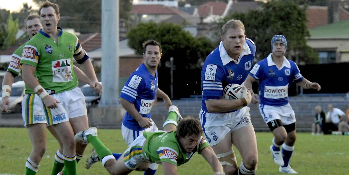 Photo caption: Here's some action from when Newtown and the Raiders last met at Henson Park in 2007. Jets backrower Nigel Plum has broken through the Raiders defence, with team-mates Josh Lewis, Jamie Soward and Shaun Foley in the background.     Photo: Gary Sutherland Photography.